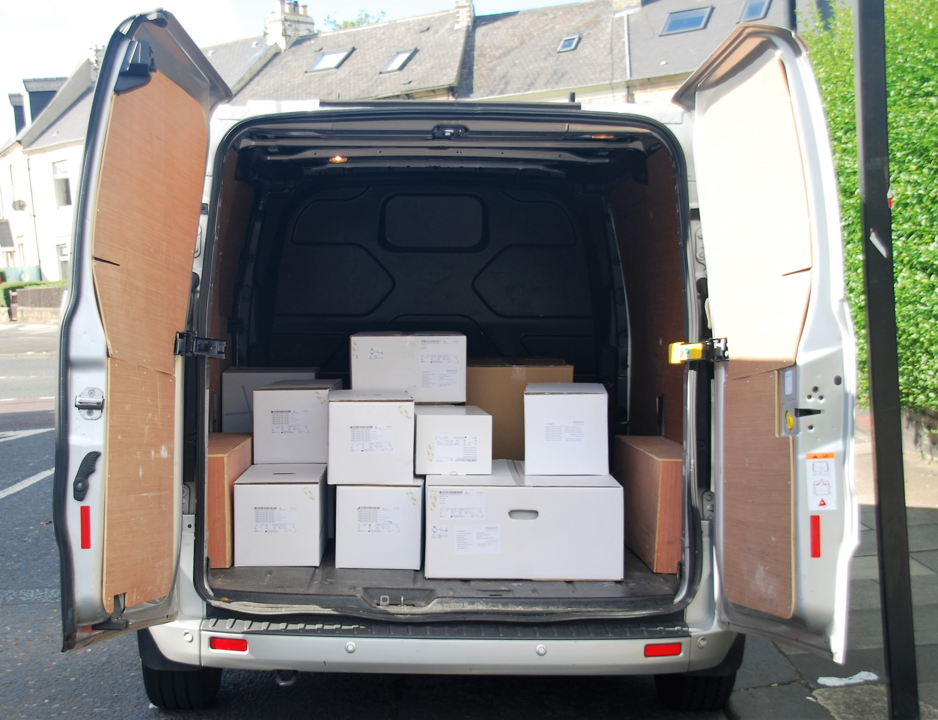 Open van showing pallet load for Connection Same Day Courier