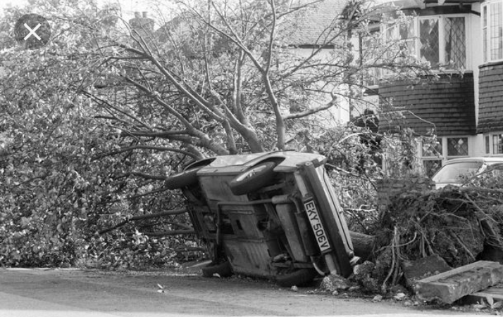 Car on it's side after Great Storm 1987